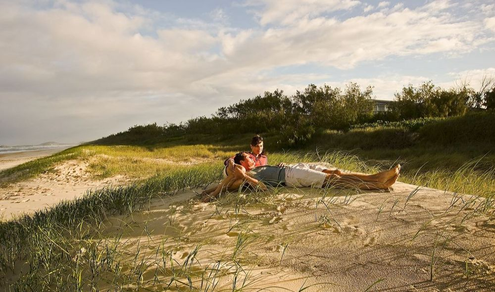 Couple lazing on beach